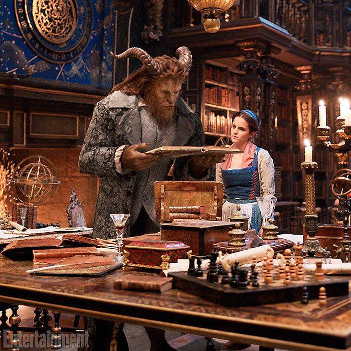 emma watson as belle beauty and the beast library books
